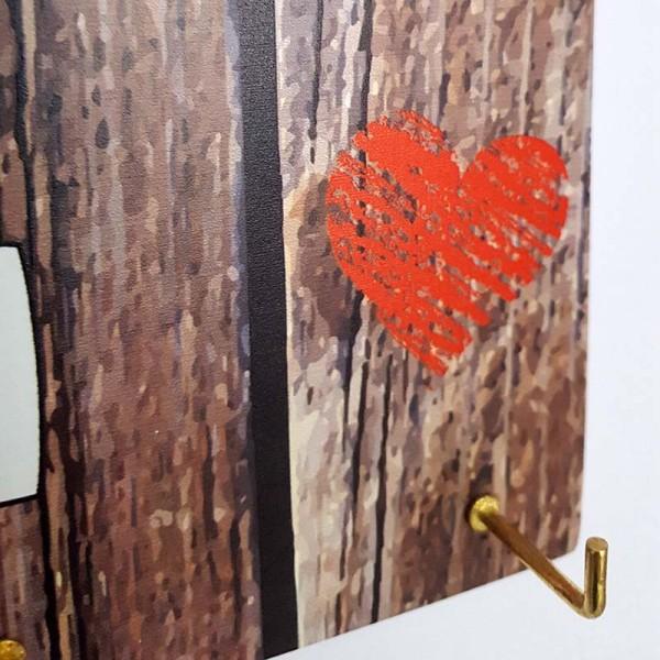 Декоративна закачалка за ключове с надпис Семейството превърна тази къща в дом